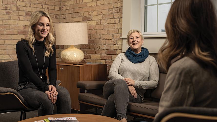 women smiling talking to recruiter